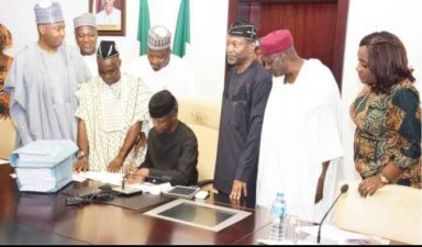 Hope rises for Nigeria as Osinbajo, backed by Buhari, signs 2017 budget