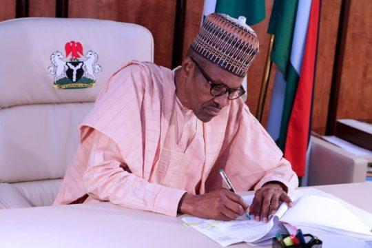 Buhari-signs-bills.jpg