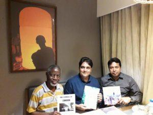 UK-based Nigerian author, Mr. Ben Igiebor, at a meeting with Rotarian Masud Parvev and his host Rotarian Noyon Jihadul, displaying his four books, at a meeting at Chittagong Bull Hotel in Gulshan, Dhaka, Bangladesh, on Sunday April 4,2018.