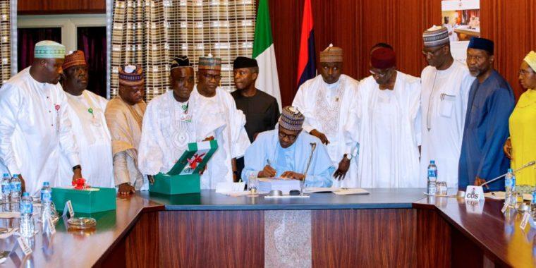 President Buhari reluctantly signs Nigeria's 2018 Budget, as Saraki, Dogara absent