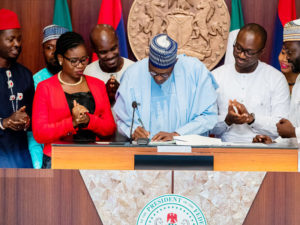 """Buhari signs """"Not Too Young to Run"""" Bill into law, charges youths to leave their mark"""