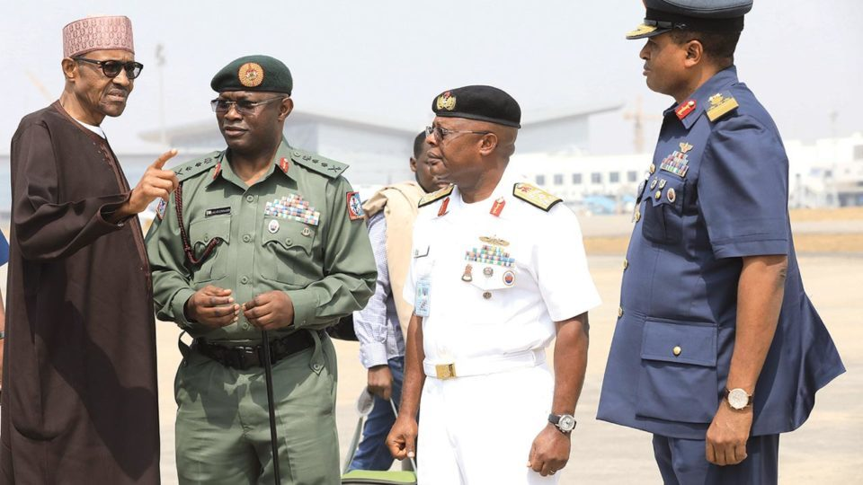 Buhari-speaking-to-service-chiefs-before-leaving-for-a-10-day-leave-last-year.jpg