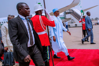 President arrives Abuja from Daura, after INEC postponed elections